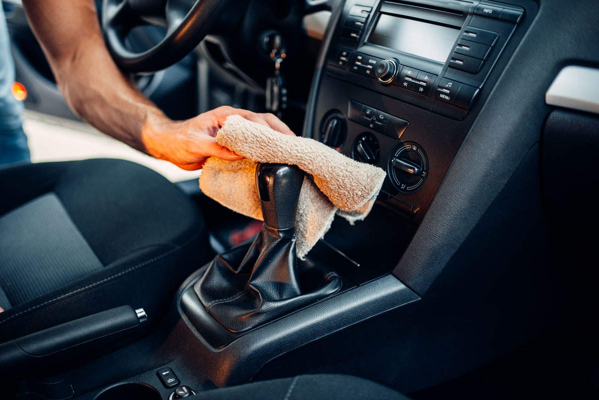 male-hands-cleans-car-interior-on-carwash-station-P4HXCFZ